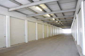 Covered outdoor drive-up units with white doors