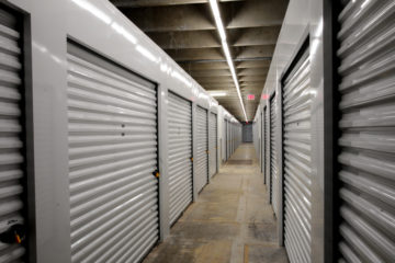 Clean, indoor hallway of white storage units